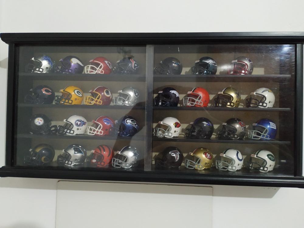 7b2ba6bd08 display mini capacete nfl 31 times futebol americano. Carregando zoom.