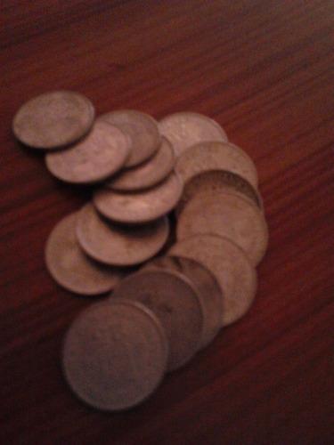 doce monedas antiguas de bs 25 centimos. venezuela. año 1978