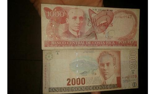 dos billetes de costa rica 1000 y 2000 colones.