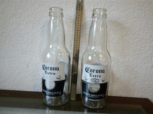 dos botellas de vidrio gigantes de corona