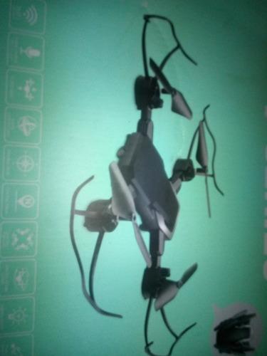 drone y series con cámara color negro y plateado