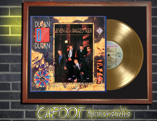duran duran seven and the ragged... lp firmado y disco oro