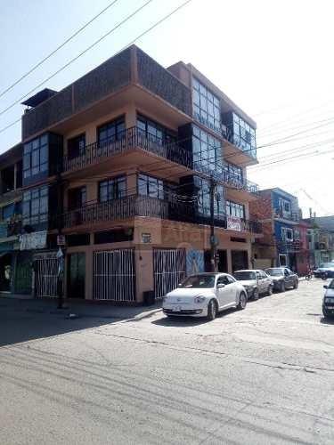 edificio con 6 departamentos y 3 locales comerciales sobre blvd inversionista