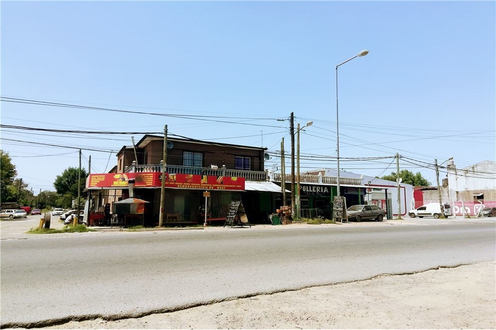 edificio con 6 departamentos y 3 locales-pilar