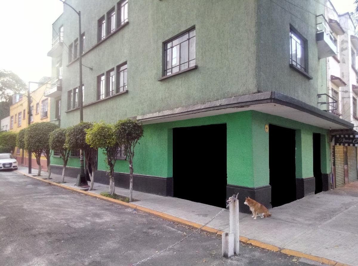 edificio con 7 departamentos y dos locales comerciales.