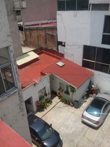 edificio con departamentos en venta