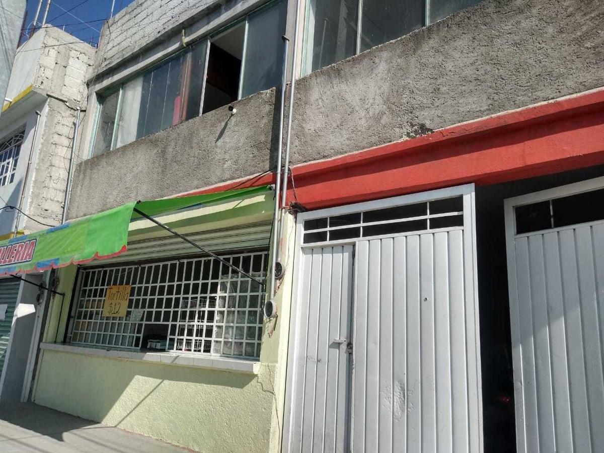 edificio con departamentos, locales comerciales y terreno