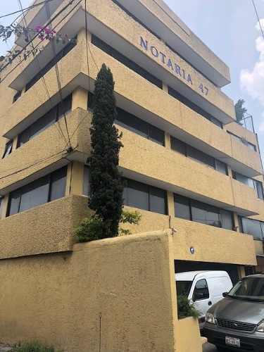 edificio con uso de suelo mixto