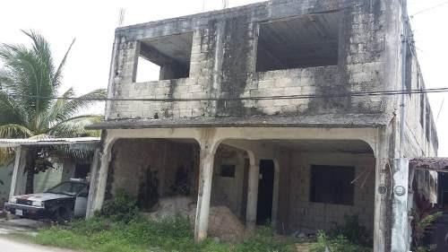 edificio de 4 departamentos en cozumel obra gris