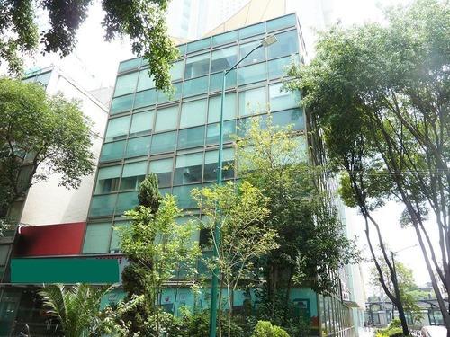 edificio de oficinas y comercio a una calle de reforma