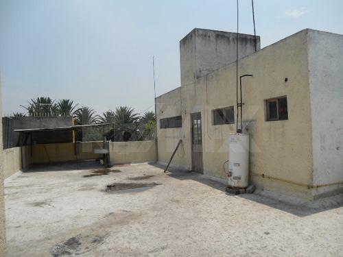 edificio en 3 niveles con uso de suelo comercial