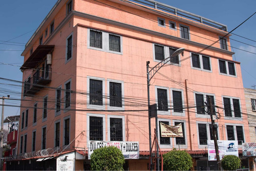 edificio mixto (departamentos y locales comerciales)