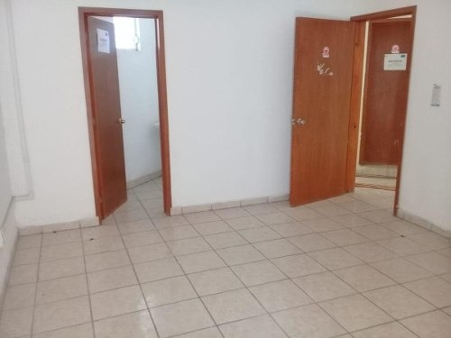 edificio para oficinas, despachos o consultorios.