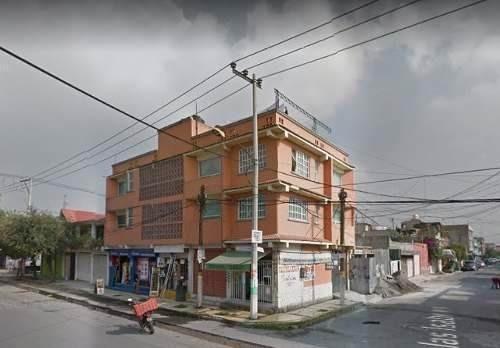 edifico con departamentos y locales  con descuento