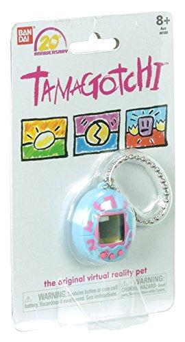 el juego electrónico original tamagotchi, azul con rosa
