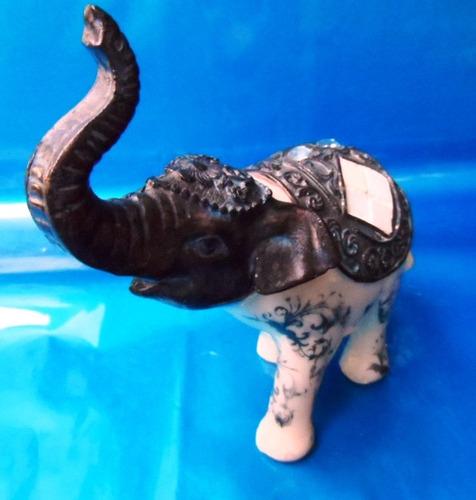 elefante decorativo feito em resina alt. 14cm x comp. 14cm