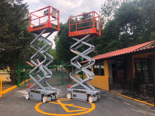elevador tijera hidráulico trabajo altura skyjack 3219 genie