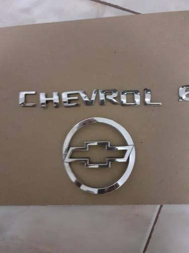 emblema  tapa maleta y letras corsa 4 puertas,original