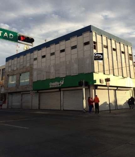 en el centro de la ciudad excelente edificio en esquina
