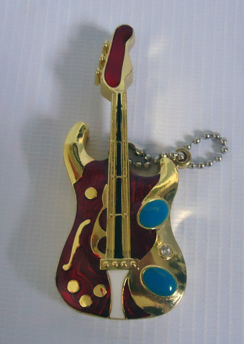 encendedor metalico guitarra psicodelica dorada exclusiva