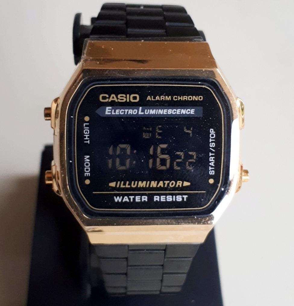 1555af9a97f2 envio gratis reloj casio vintage bicolor negro dorado metal. Cargando zoom.
