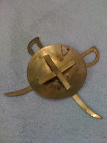 escudito de bronce