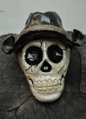 escultura cráneo cowboy