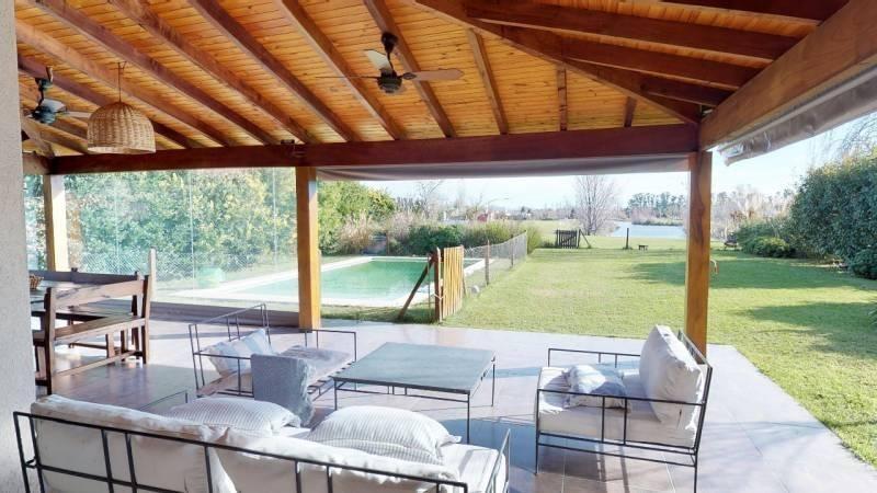 espectacular casa a la laguna en estancias del pilar - mallmann propiedades