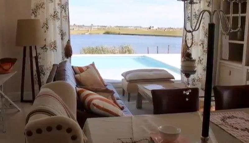 espectacular casa a la laguna en puertos muelles