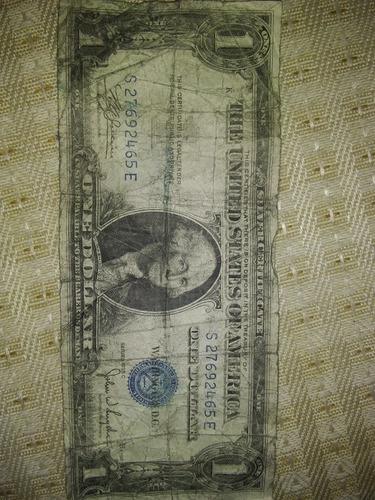 estoy vendiendo un billete de un dollar silver sello azul