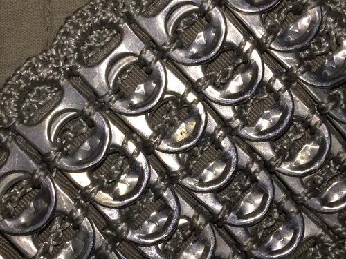 estuche reciclado confeccionada c/ chapitas gaseosa liquido