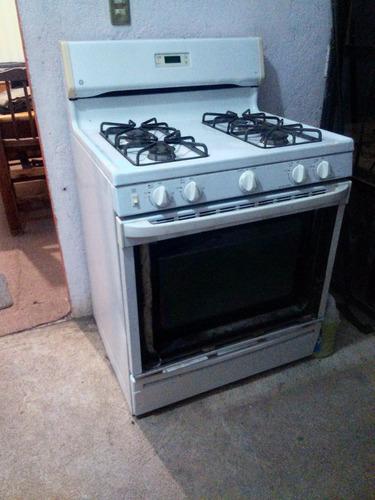 estufa,cuatro quemadores,horno doble,electrica.