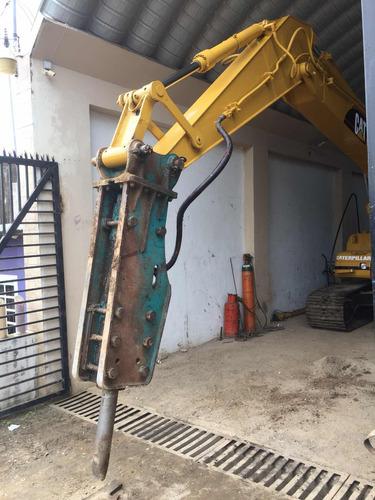 excavadora 320bl caterpillar con martillo hidráulico