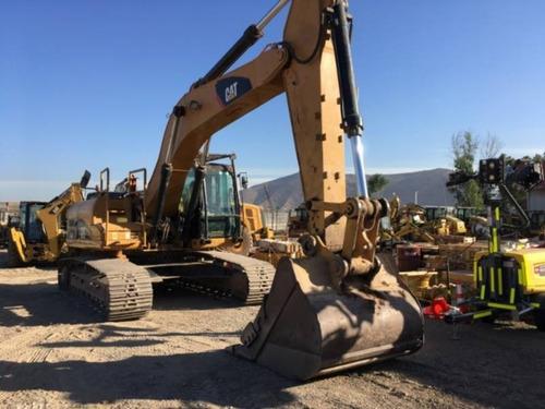 excavadora 329dl  con 8840 horas valor neto