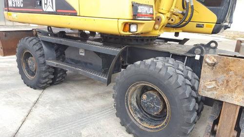 excavadora caterpillar todo terreno sobre ruedas