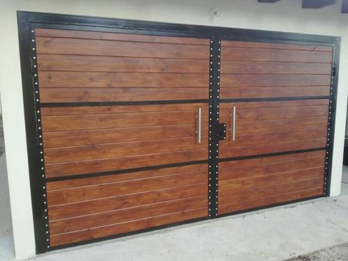 excelentes portones en hierro y madera
