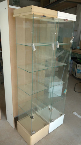 exhibidor columna ,vitrina, con luz.y cerradura