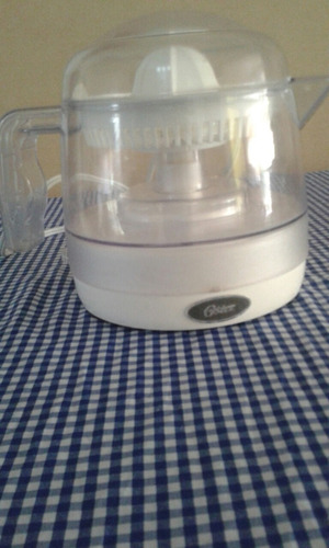 exprimidor de jugo electrico oster