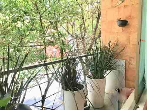 exterior con balcón