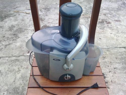extractor de jugo oster