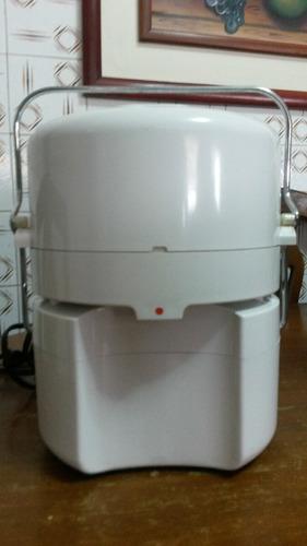 extractor de jugos braun