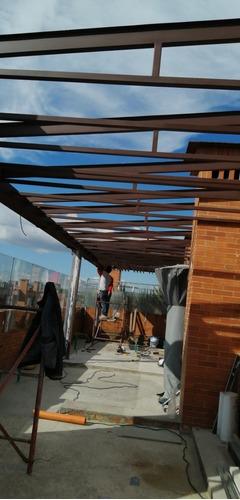 fabrica carpintería y estructuras metalicas