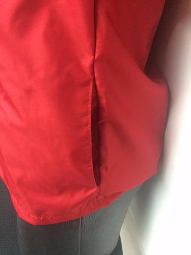 fabrica, chaqueta rompeviento, neon, chalecos, publicidad.