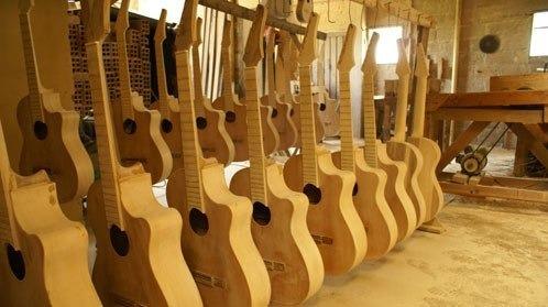 fabrica reparacion instrumentos musicales guitaras teclados