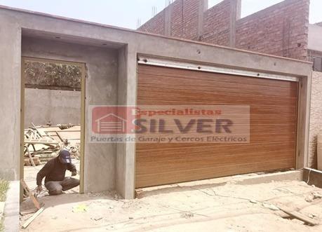 fabricación e instalación de puerta seccional
