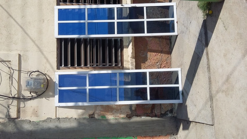 fabricación e instalación de puertas, rejas y ventanas.
