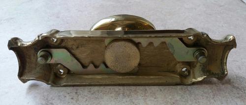 falleba-manija de bronce macizo, pulido,para ventanas.