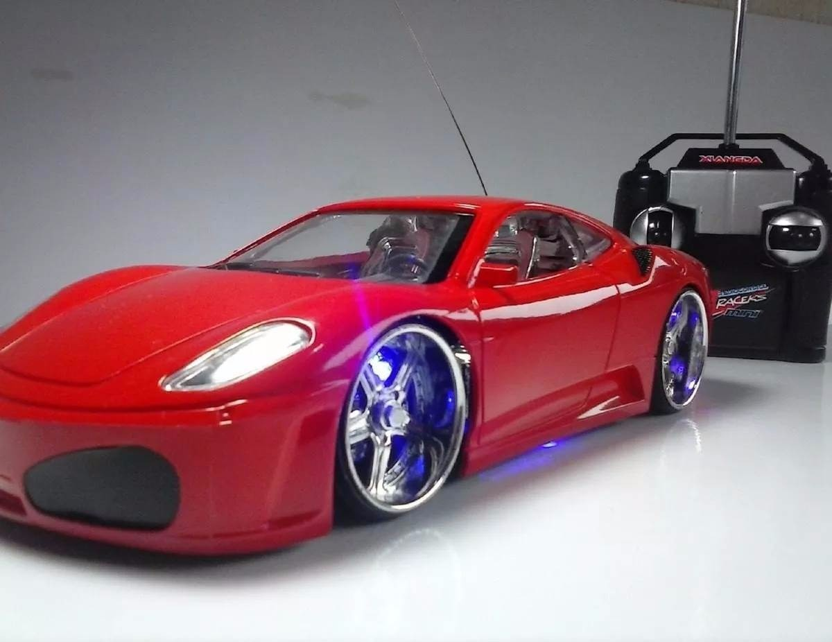 ferrari-carro-carrinho-controle-remoto-leds-rodas-farol-neon-D_NQ_NP_595905-MLB25085182739_102016-F.jpg