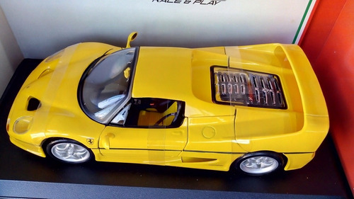 ferrari f50 color amarillo a escala 1:18 marca bbugago metal