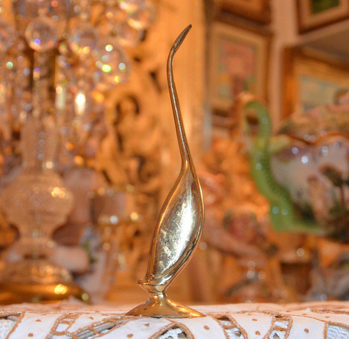 figura antigua de ave de bronce macizo.